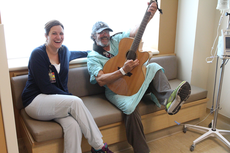 Bradley Armstrong, a patient on NBRHC's surgical unit (right) pictured with Emily Morin, the Health Centre's Recreational Therapist who helped organize the performance.